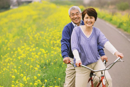 Middle-Aged Couple on Tandem Bicycle Together